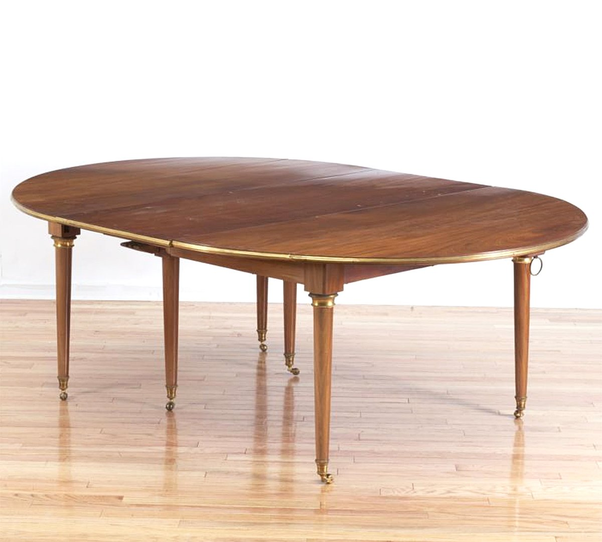 A Louis XVI Brass Mounted  Mahogany Dining Table