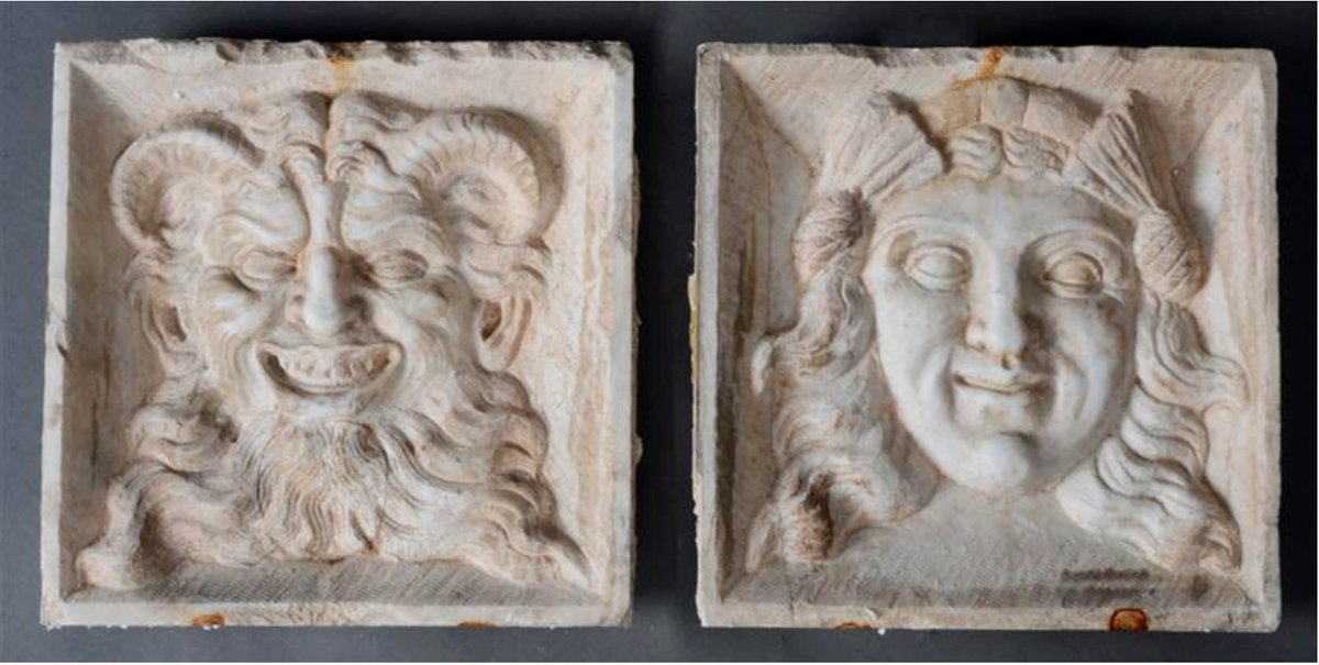 A Fine Pair of Early Carved Marble Reliefs Each carved with a Bacchic Mask