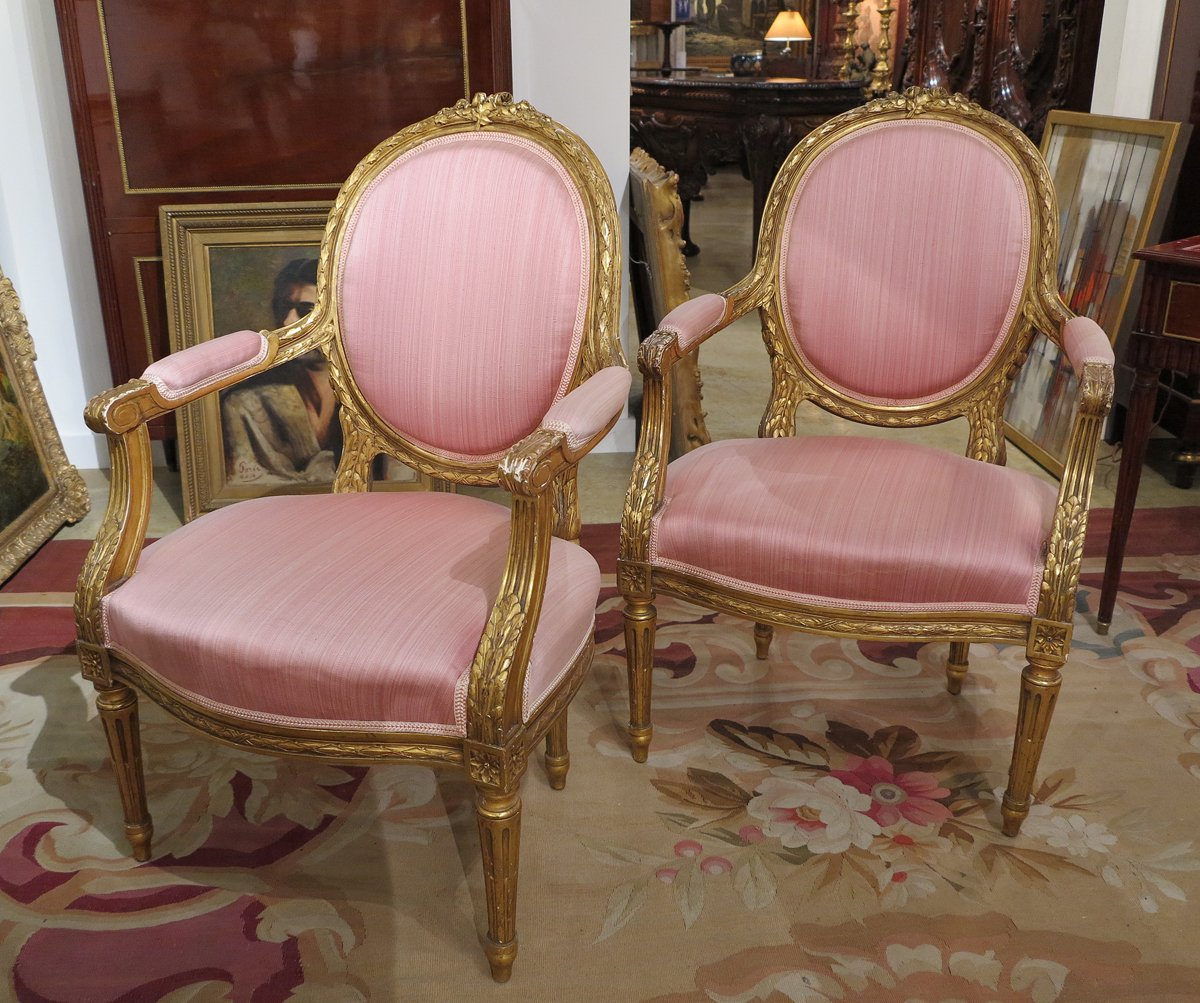 A Pair of Louis XVI Style Giltwood Armchairs